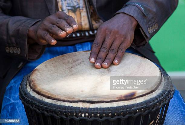 A bongo drum being played by a drummer featuring the drum and hands only pictured on April 27 2013 om Accra Ghana