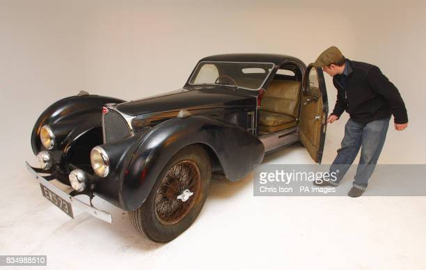 Bonhams auctioneer's consultant Nicholas Benwell looks inside a rare 1937 Bugatti Type 57S in Hartley Witney Hampshire which will go to auction at...