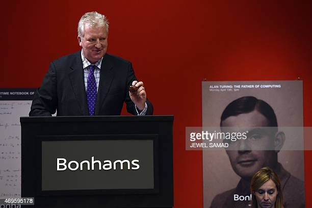 Bonhams cochief executive officer Patrick Meade administrates an auction of an original 1944 Enigma Machine in New York on April 13 2015 The Enigma...