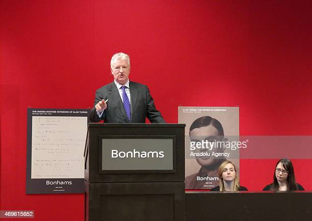 Bonhams cochief executive officer Patrick Meade is seen during auction of an original 1944 Enigma Machine in New York on April 13 2015 The German...
