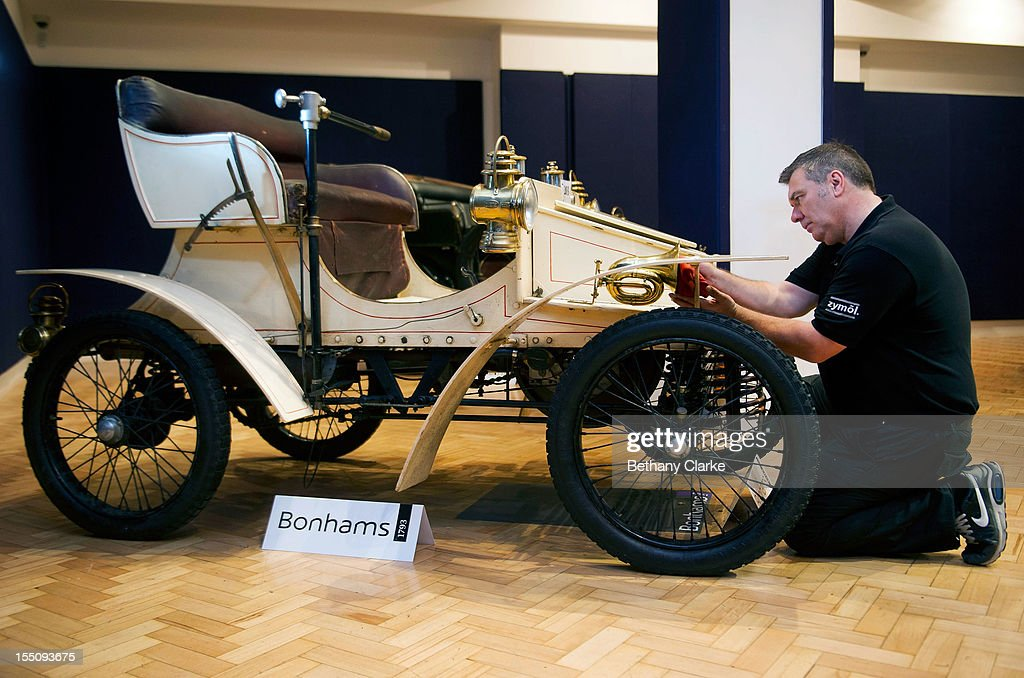 Bonhams employee Craig Binns polishes a, 1903 two seater moter car, the world oldest surviving Vauxhall, on November 1, 2012 in London, England. The Car is part of a Veteran Car Sale at Bonhams and is valued at around 80,000 pounds