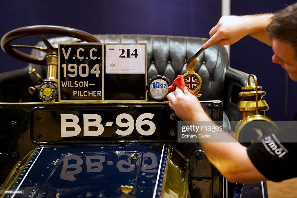 Bonhams employee Craig Binns polishes a 1904 Wilson-Pilcher, thought to be the oldest surviving example of its type on November 1, 2012 in London, England. The Car is part of a Veteran Car Sale at Bonhams and is valued at around 220,000 pounds