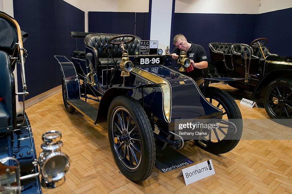 Bonhams employee Craig Binns polishes a1904 Wilson-Pilcher, thought to be the oldest surviving example of its type on November 1, 2012 in London, England. The Car is part of a Veteran Car Sale at Bonhams and is valued at around 220,000 pounds