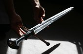 Bonhams employee holds 'Anduril' a prop sword belonging to Aragorn hero of 'The Lord of the Rings' movie trilogy on July 31 2014 in London England...