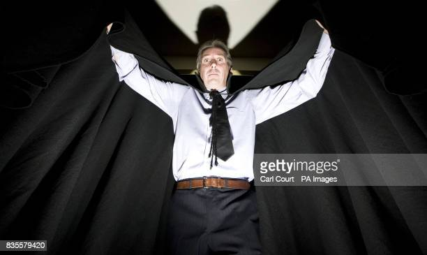 A Bonhams employee models the cape worn by Christopher Lee in his 1958 horror film Dracula at the auctioneer's Knightbridge showroom London The item...