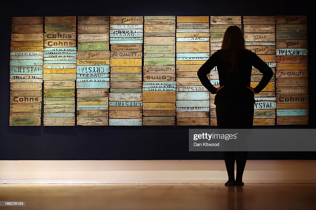 A Bonhams employee poses in front of a piece of work by Australian artist Rosalie Gascoigne entitled Scrub Country, 1981, at Bonhams auction house on May 7, 2013 in London, England. The piece is expected to fetch between $600,000 - $800,000 AUS (approximately £400,000-500,000 GBP) when it goes up for auction at an Australian Art sale at Bonhams in Sydney on June 26, 2013. The collection, which has never been seen before in public belongs to Neighbours producer Reg Grundy.