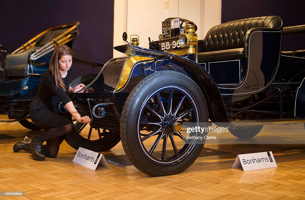 Bonhams employee, Sarah Gubbins pictured with a 1904 Wilson-Pilcher, thought to be the oldest surviving example of its type on November 1, 2012 in London, England. The Car is part of a Veteran Car Sale at Bonhams and is valued at around 220,000 pounds