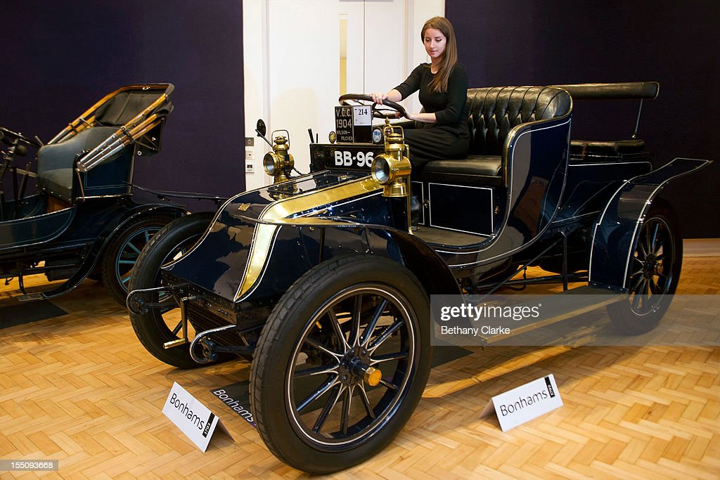 Bonhams employee, Sarah Gubbins sits in a 1904 Wilson-Pilcher, thought to be the oldest surviving example of its type on November 1, 2012 in London, England. The Car is part of a Veteran Car Sale at Bonhams and is valued at around 220,000 pounds
