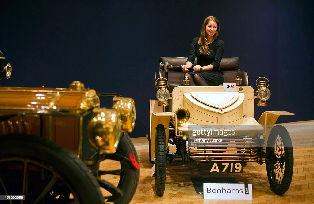 Bonhams employee Sarh Gubbins sits in a, 1903 two seater moter car, the world oldest surviving Vauxhall, on November 1, 2012 in London, England. The Car is part of a Veteran Car Sale at Bonhams and is valued at around 80,000 pounds