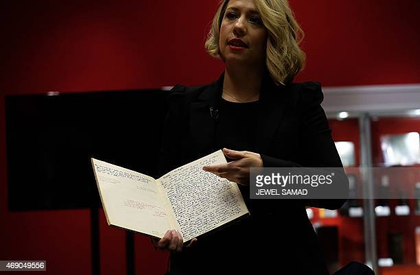 Bonhams' History of Science and Technology department director Cassandra Hatton shows a handwritten manuscript belonging to British mathematician and...