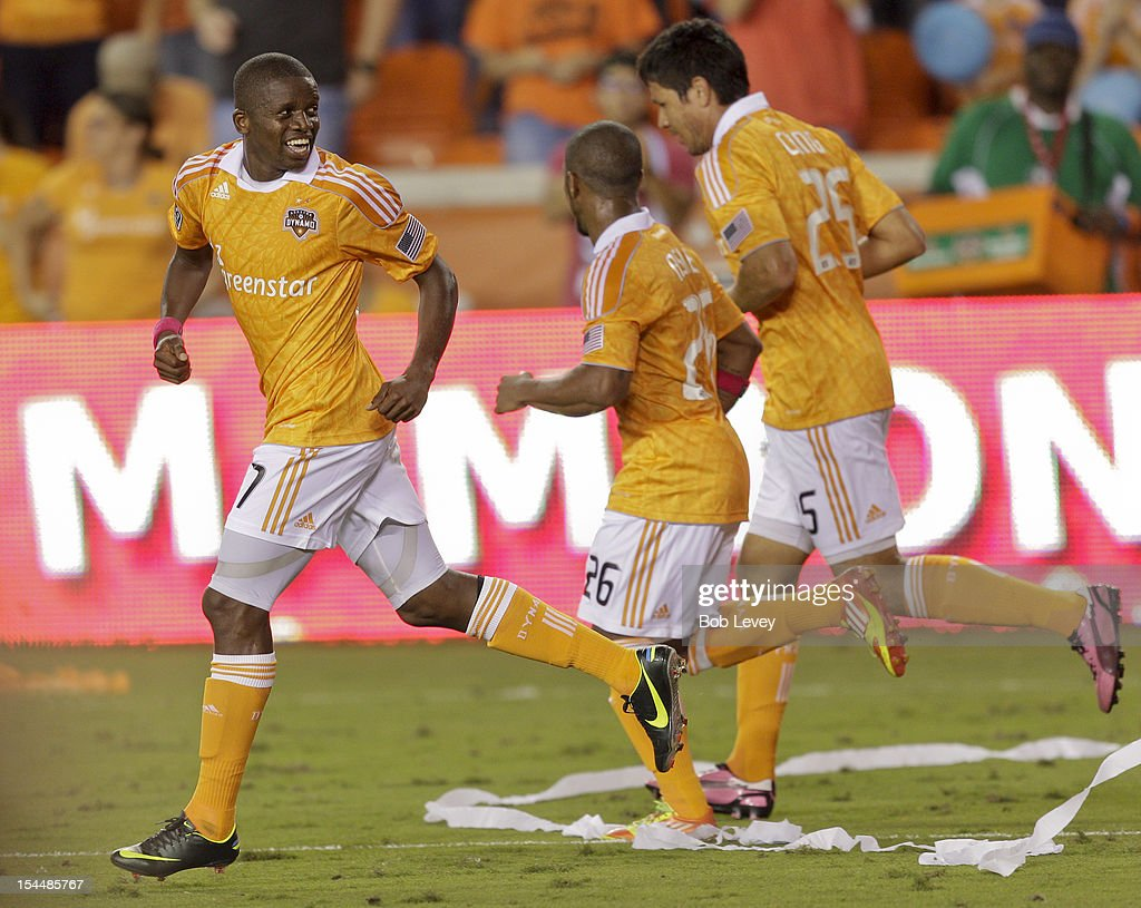 Boniek Garcia #27 celebrates his score in the second half against the Philadelphia Union with <a gi-track='captionPersonalityLinkClicked' href=/galleries/search?phrase=Brian+Ching&family=editorial&specificpeople=453218 ng-click='$event.stopPropagation()'>Brian Ching</a> #25 and Boniek Garcia #27 of the Houston Dynamo at BBVA Compass Stadium on October 20, 2012 in Houston, Texas. Houston won 3-1.