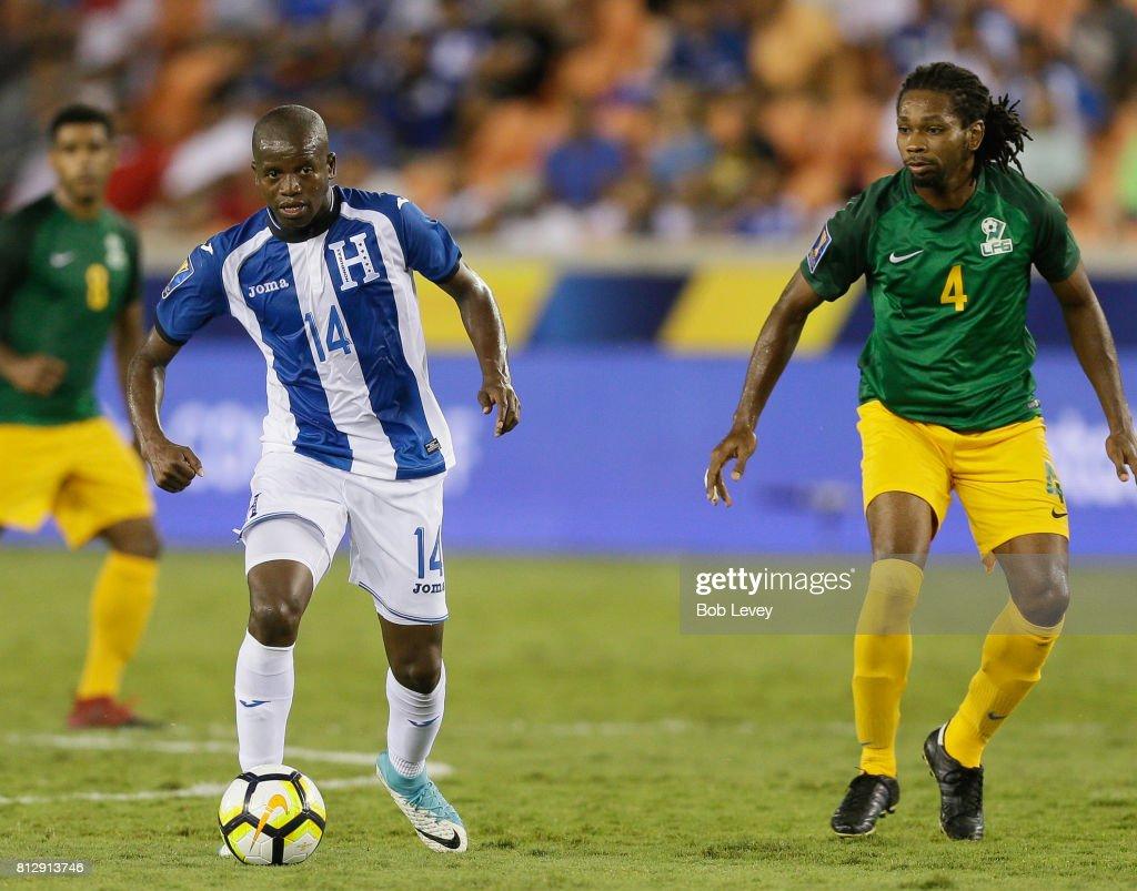 Boniek Garcia #14 of Honduras dribbles around Rhudy evens #4 of French Guiana in the second half at BBVA Compass Stadium on July 11, 2017 in Houston, Texas.