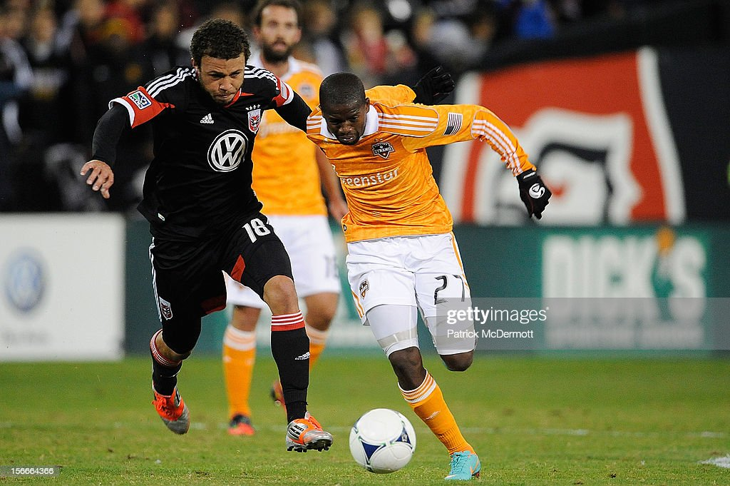 Boniek Garcia #27 of Houston Dynamo battles for the ball against Nick DeLeon #18 of D.C. United during leg 2 of the Eastern Conference Championship at RFK Stadium on November 18, 2012 in Washington, DC.