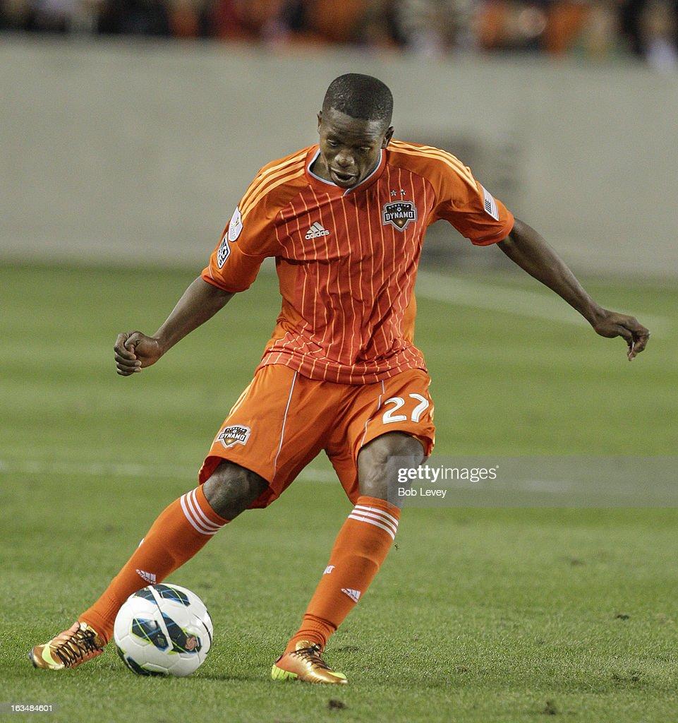 Boniek Garcia #27 of Houston Dynamo during leg one of a CONCACAF Champions League quarterfinal match between the Houston Dynamo and Santos Laguna at BBVA Compass Stadium on March 5, 2013 in Houston, Texas.
