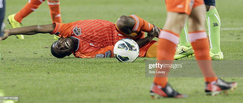 Boniek Garcia #27 of Houston Dynamo lays on the pitch in pain after a hard tackle during the second half at BBVA Compass Stadium on March 5, 2013 in Houston, Texas.