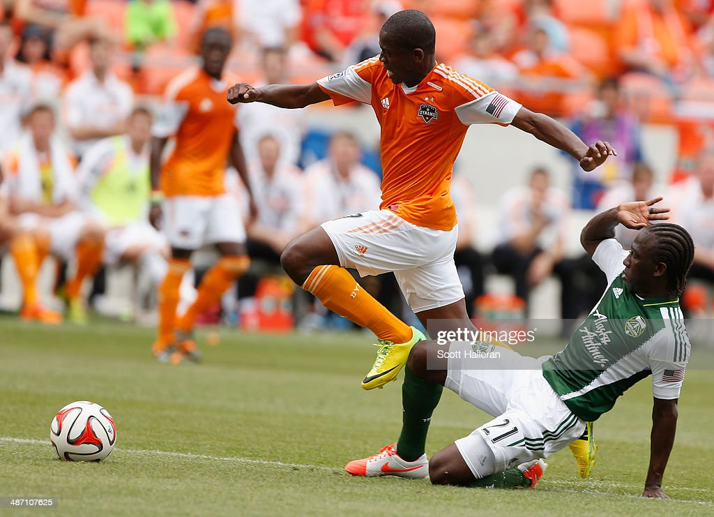 Boniek Garcia #27 of the Houston Dynamo battles for the ball with Diego Chara #21 of the Portland Timbers during the first half of their game at BBVA Compass Stadium on April 27, 2014 in Houston, Texas.