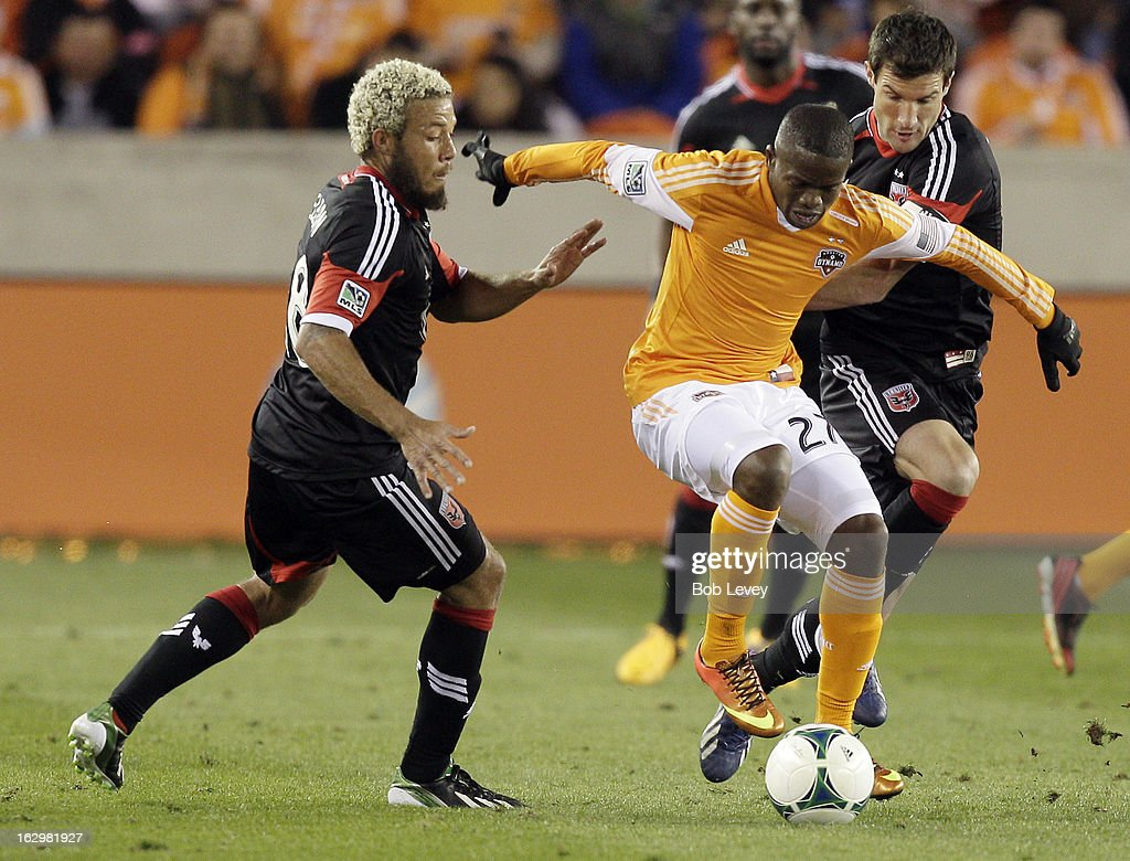 Boniek Garcia #27 of the Houston Dynamo controls the ball as he is pressured by Nick DeLeon #18 of the D.C. United during first half action at BBVA Compass Stadium on March 2, 2013 in Houston, Texas.