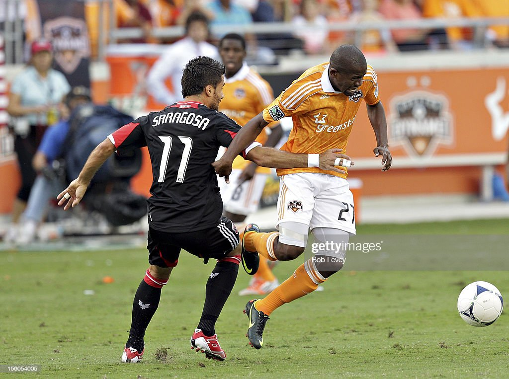 Boniek Garcia #27 of the Houston Dynamo is tripped up by <a gi-track='captionPersonalityLinkClicked' href=/galleries/search?phrase=Marcelo+Saragosa&family=editorial&specificpeople=178311 ng-click='$event.stopPropagation()'>Marcelo Saragosa</a> #11 of the D.C. United in the first half during Leg 1 of the MLS Eastern Conference Championship at BBVA Compass Stadium on November 11, 2012 in Houston, Texas.