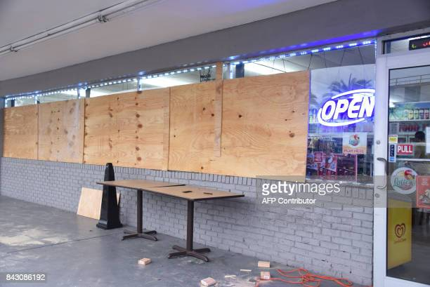 Bonjour Food Market prepares for Hurricane Irma on September 5 2017 in Miami The monster hurricane coming on the heels of Harvey which struck Texas...