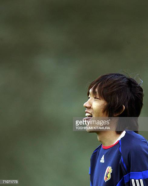Japan's midfielder Shunsuke Nakamura takes a break during their training session at the North Sport Park in Bonn 28 May 2006 The Japanese National...