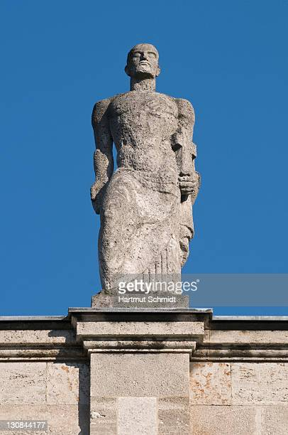 Bonn University main building, male statue with a cross located on the front side facing the city, North Rhine-Westphalia, Germany, Europe