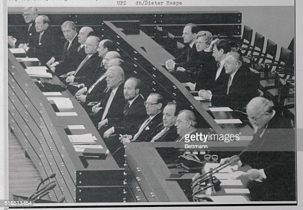 Rainer Barzel president of the Bundestag right addresses Parliament as the newly appointed cabinet members sit in the government bench Front from...