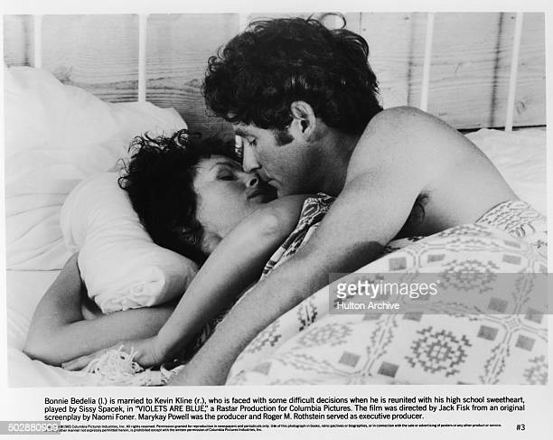 Bonnie Bedelia and Kevin Kline in a romantic scene for the movie 'Violets Are Blue' circa 1985