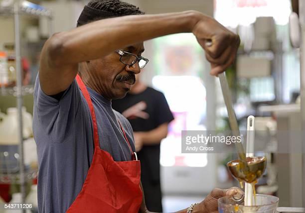 Bonnie Brae Ice Cream chef Richard Brown measures fresh peaches for a Peach Amaretto ice cream June 29 2016 Brown has worked at Bonnie Brae Ice Cream...