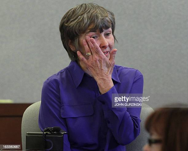 Bonnie Brunson plaintiff wipes tears from her eyes during testimony Friday March 8 2013 in Las Vegas for the role of Health Plan of Nevada in the...