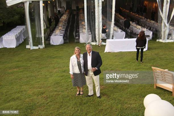 Bonnie Comley and Stewart Lane attend the Guild Hall Summer Gala 2017 at Guild Hall and private residence on August 11 2017 in East Hampton New York
