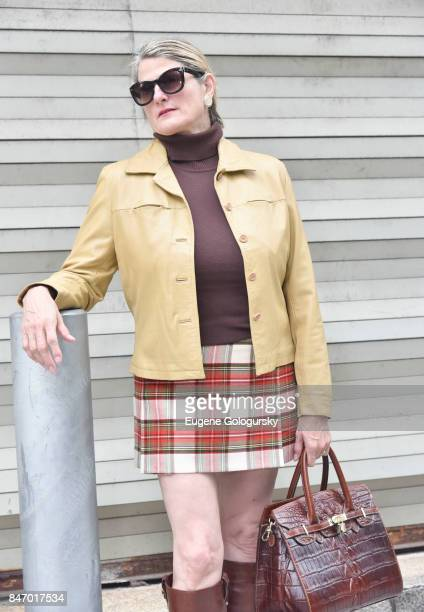 Bonnie Comley wearing Burberry plaid skirt seen during NY Fashion Week on September 14 2017 in New York City