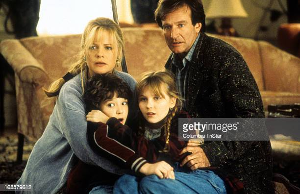 Bonnie Hunt Bradley Pierce Kirsten Dunst and Robin Williams hold each other in a scene from the film 'Jumanji' 1995
