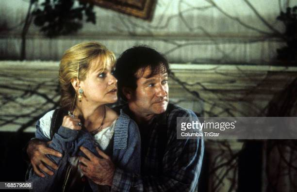 Bonnie Hunt is held by Robin Williams in a scene from the film 'Jumanji' 1995
