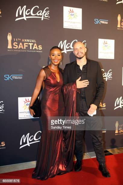 Bonnie Mbuli and her partner Nathanial Roloff pose on the red carpet during the South African Film and Television Awards at Sun City on March 18 2017...