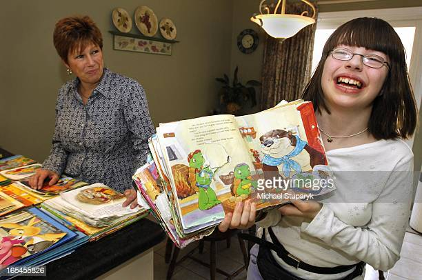 Bonnie McPhail and her daughter Kristy McPhail age l4 who has autism showing some of her favourite books and characters including Franklin the Turtle