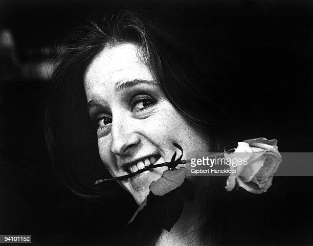 Bonnie Raitt posed with a rose between her teeth in Amsterdam Netherlands in 1976