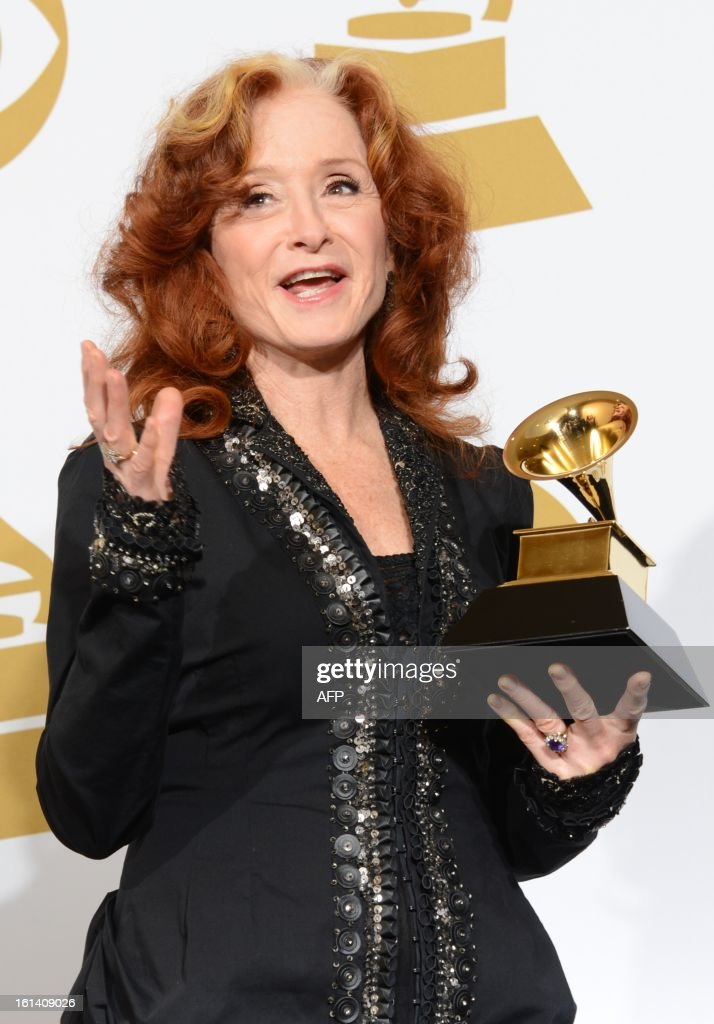 Bonnie Raitt poses with her trophy for Best Americana album for 'Slipstream' in the press room at the Staples Center during the 55th Grammy Awards in Los Angeles, California, February 10, 2013. AFP PHOTO Robyn BECK