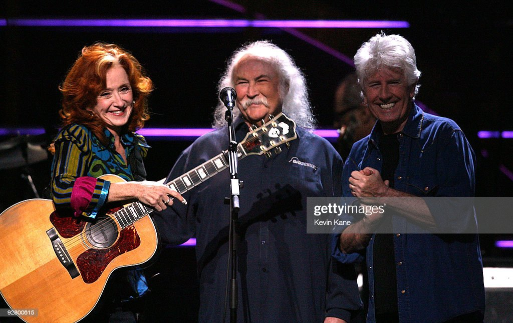Bonnie Raitt with Graham Nash and David Crosby of Crosby, Stills and Nash performs onstage at the 25th Anniversary Rock & Roll Hall of Fame Concert at Madison Square Garden on October 29, 2009 in New York City.