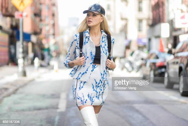 Bonnie Strange wearing a Longchamps skirt and jacket white boots Skinny Dip backpack Weekday cap on February 13 2017 in New York City