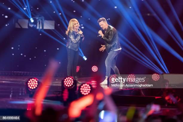 Bonnie Tyler and Ben Zucker perform during the show 'Das Internationale Schlagerfest' at Westfalenhalle on October 21 2017 in Dortmund Germany