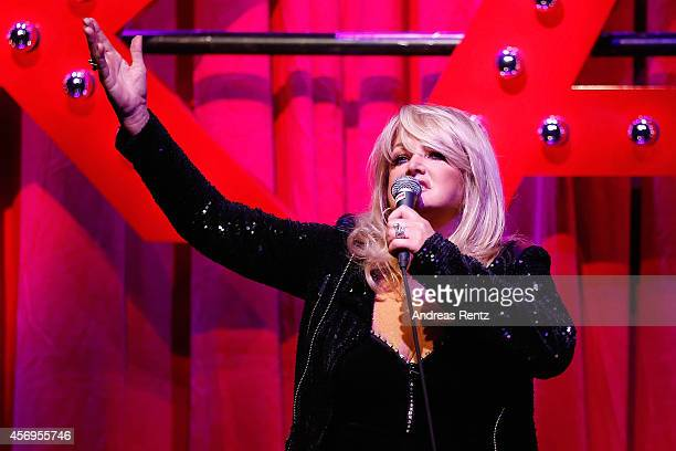 Bonnie Tyler performs on stage during the Grand opening of KARE Kraftwerk store on October 9 2014 in Munich Germany