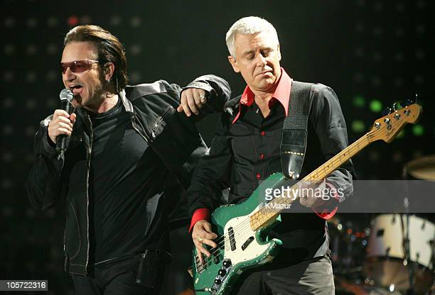 Bono and Adam Clayton of U2 during U2 'Vertigo//2005' World Tour Opener San Diego at San Diego Sports Arena in San Diego California United States