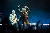 Bono and Adam Clayton of U2 perform at the SSE Hydro as part of their iNNOCENCE eXPERIENCE tour on November 6 2015 in Glasgow Scotland
