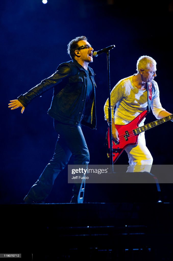 Bono and Adam Clayton of U2 perform during their 360 Degree Tour stop at Lincoln Financial Field on July 14 2011 in Philadelphia Pennsylvania