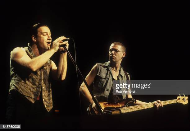 Bono and Adam Clayton of U2 perform on stage on the Joshua Tree tour Vorst Nationaal Brussels Belgium 8th July 1987