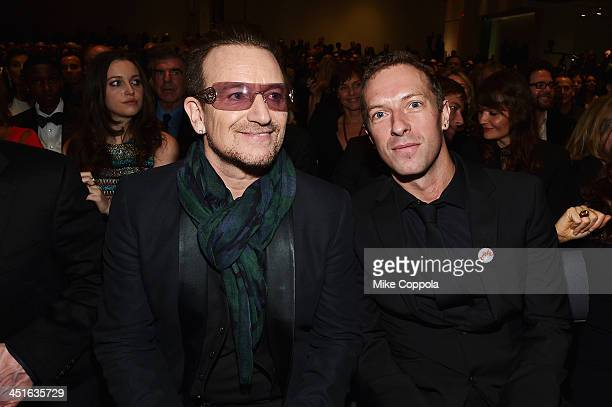 Bono and Chris Martin attend Jony And Marc's Auction at Sotheby's on November 23 2013 in New York City Photo by Mike Coppola/Getty Images for
