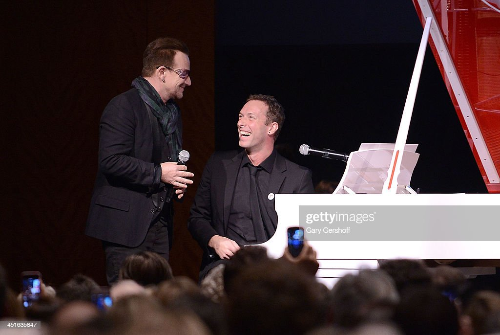 <a gi-track='captionPersonalityLinkClicked' href=/galleries/search?phrase=Bono+-+Singer&family=editorial&specificpeople=167279 ng-click='$event.stopPropagation()'>Bono</a> (L) and Chris Martin perform on stage at Sotheby's during the 2013 (RED) Auction Celebrating Masterworks Of Design and Innovation on November 23, 2013 in New York City.