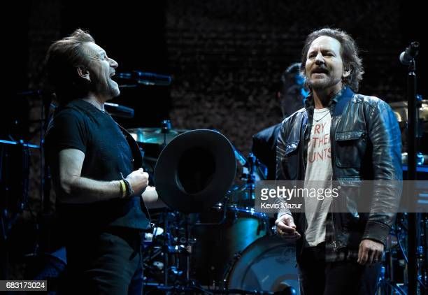 Bono and Eddie Vedder perform onstage during U2 'Joshua Tree Tour 2017' at CenturyLink Field on May 14 2017 in Seattle Washington
