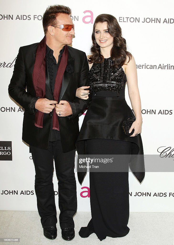 Bono (L) and his daughter Eve Hewson arrive at the 21st Annual Elton John AIDS Foundation Academy Awards viewing party held at West Hollywood Park on February 24, 2013 in West Hollywood, California.