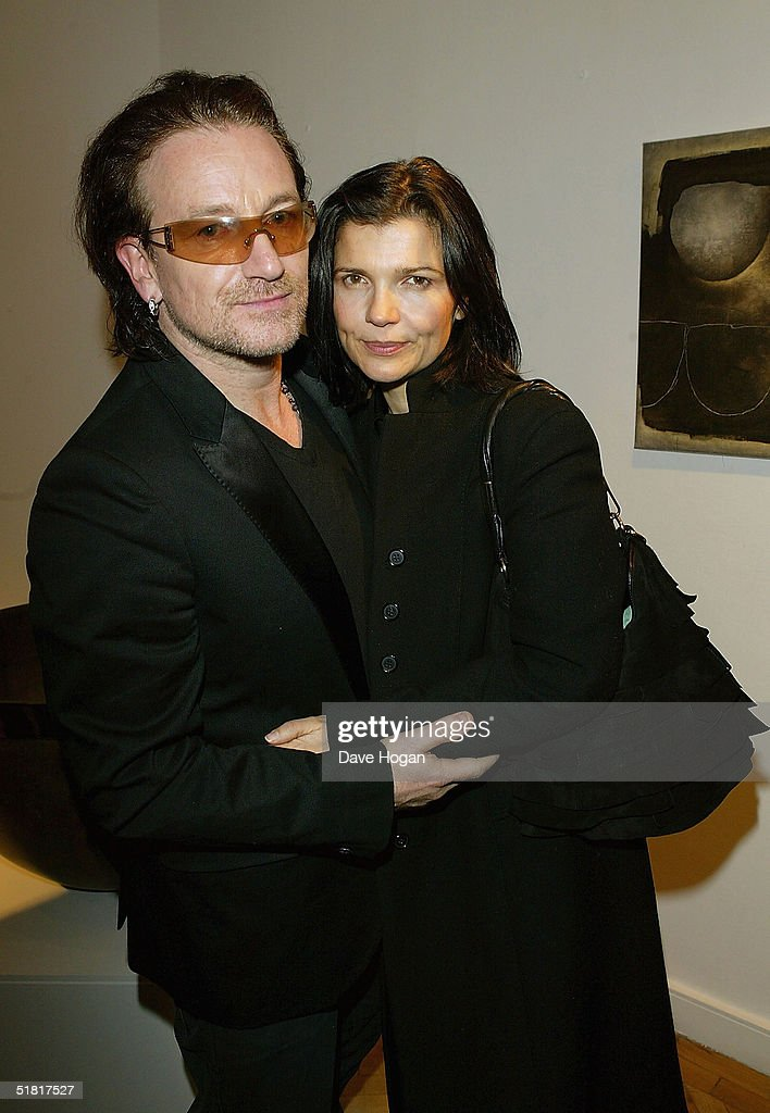 Bono and his wife Ali Hewson attend the opening of the new collection by the artist Guggi at the Osbourne Samuel Gallery on December 1, 2004 in London.